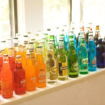 rainbow of beverages - do this with water bottles & food coloring - wrap with printed lego labels