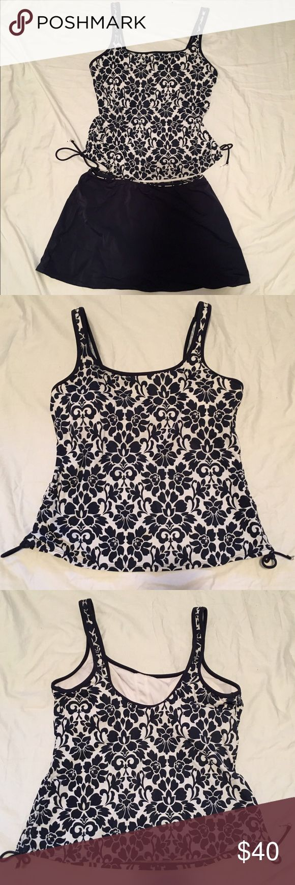 Navy Blue and White Floral Tankini Beautiful white and navy blue floral patterned tankini top with navy blue swim skirt. Only worn once. The top has adjustable ruching on the lower sides (picture 4) and a soft cup (picture 5). Skirt has a patterned waistband (picture 7) and attached scoop liner (picture 8). croft & barrow Swim Bikinis