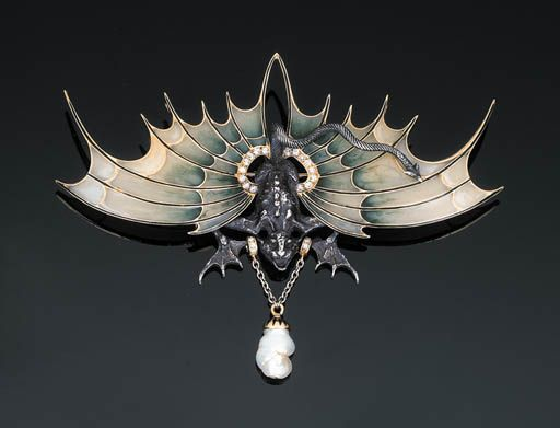 A Diamond-set Winged Dragon Brooch   The central dragon of chased silver body, webbed feet and scrolled tail, outstretched translucent wings and a suspended baroque pearl drop with circular-cut diamond detail, the mount with initials E.G., Paris, with inventory mark, 11.5 cm wide