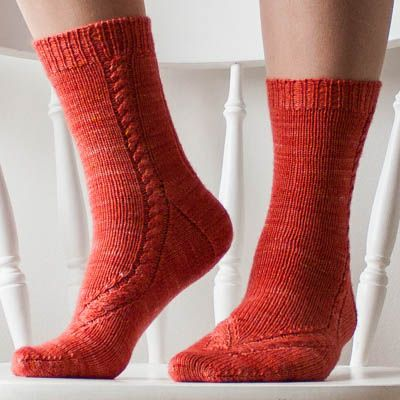 A sock knitting pattern to make cabled socks. The socks are knitted from…