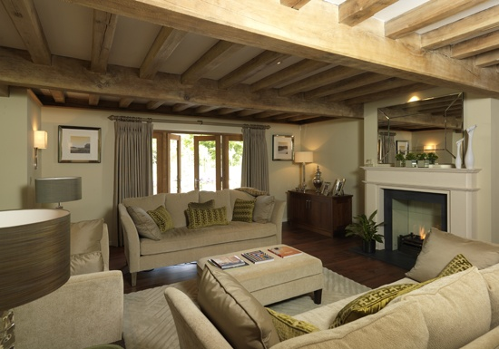 Large sitting room with oak floor beams and joists above for French doors that open out
