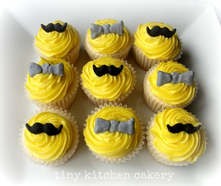 Little Gentlemen mini cupcakes - black mustache and gray bowtie cupcake toppers  www.facebook.com/tinykitchencakery