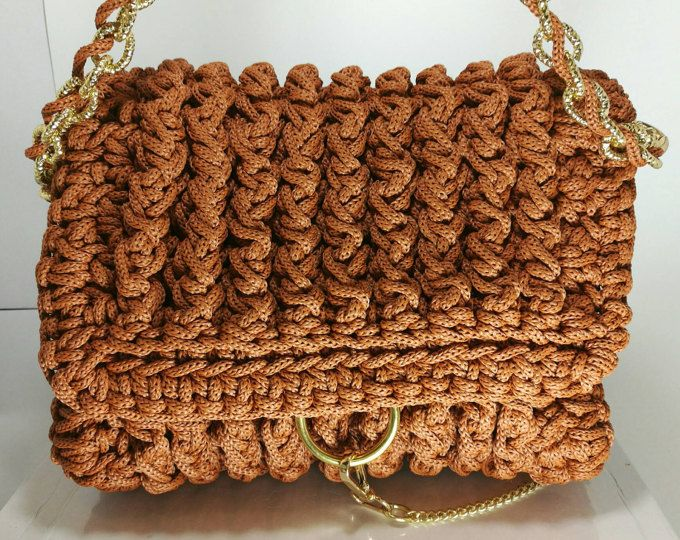Women's deep orange color handbag with gold details/Crochet