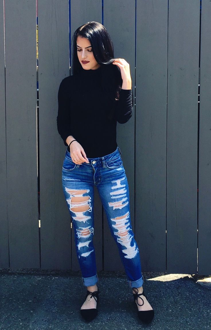 Black turtle neck American eagle ripped jeans ginger Kylie lip kit black tie flats