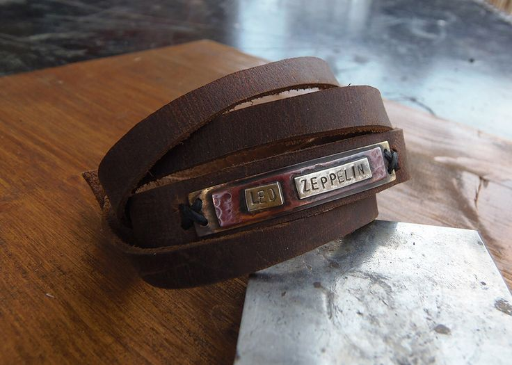 Rock band bracelet! Handmade leather bracelet with a bronze, copper and sterling silver 925 handstamped plate! by VakalisCreations on Etsy https://www.etsy.com/listing/235304802/rock-band-bracelet-handmade-leather