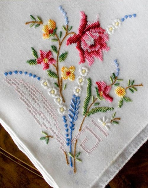 (via Antique Style: Hanky Primer #3: Embroidered and Petit Point Hankies)  Nice combination of stitches, though if ever I'll try and embroider this I guess I would use french knots rather than cross stitch.
