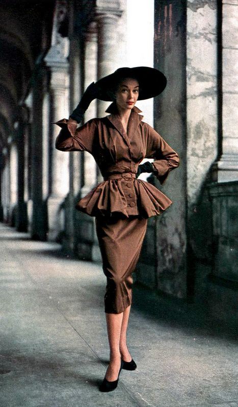 1950 Jean Patchett in bronze rayon suit with peplum jacket by unidentified designer, Harper's Bazaar.