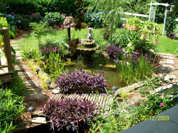 Landscaping around a small pond member inspired for Pond shade ideas
