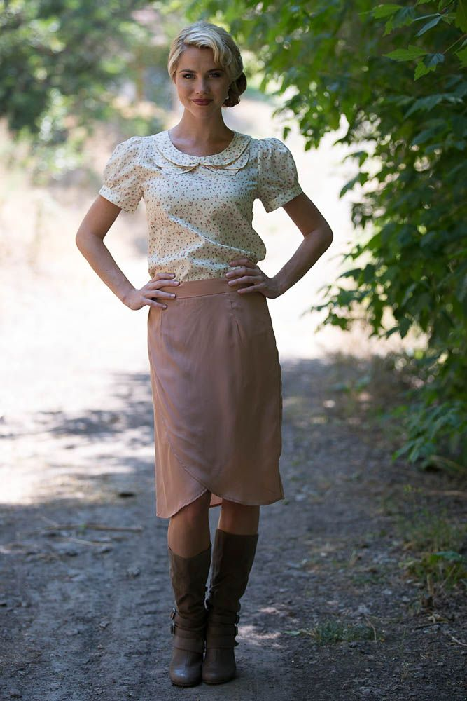 This rose colored skirt has a darling scalloped crossover hemline in the front. …