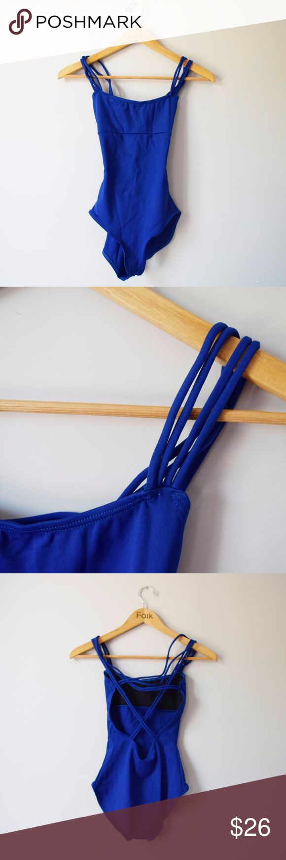 Capezio Royal Blue Leotard NEW Capezio Leotard in royal blue with strap detail in front and back. No tags, but unworn and in perfect condition. See photos for front lining. Women's size SM. Perfect dance wear, activewear or for layering under shorts, skirts, jeans, sheer dresses! Capezio Other