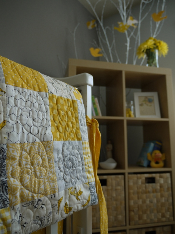yellow/grey combo...a good theme for gender neutral baby room.