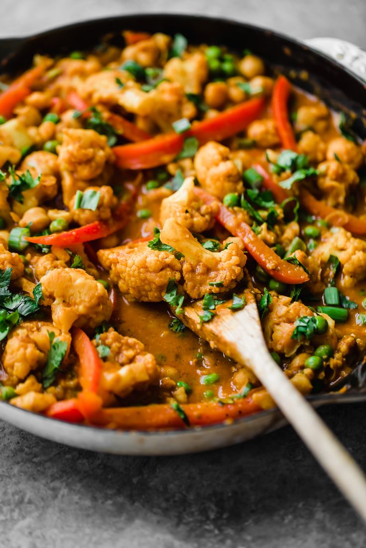 Flavorful Thai peanut coconut cauliflower chickpea curry is packed with bold flavors and plant-based protein. Make this cozy, vegetarian dish in one pan for the perfect weekday meal!