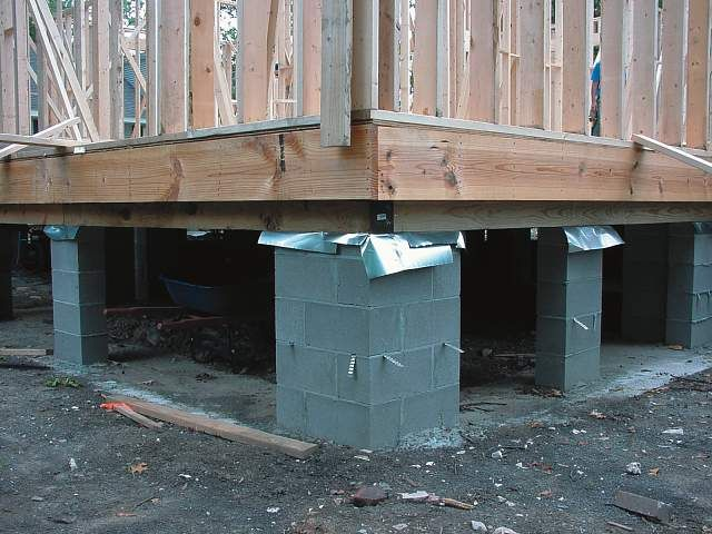 Construction images raised floor living foundation for Building a house on concrete piers