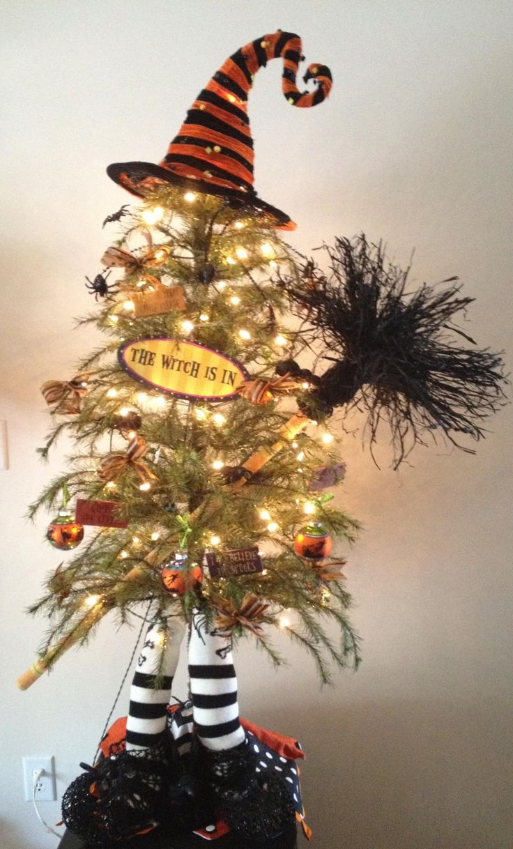 this is a samhain witch tree but what a great idea and could be converted easily to a yule tree maybe little witch hats as ornaments - Halloween Tree Ornaments