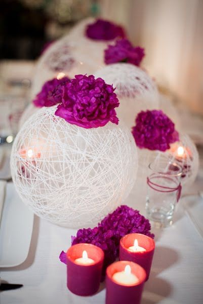 This would be an easy decoration for us to make for the engagement party. We could easily hang them around! Wind string around a balloon, cover with fabric stiffener, dry and then pop the balloon- Cute and Crafty for any wedding or home center piece -- not purple though