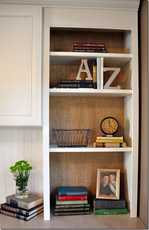How to Use Burlap as Wallpaper. Cheap and inexpensive solution to boring book shelves!