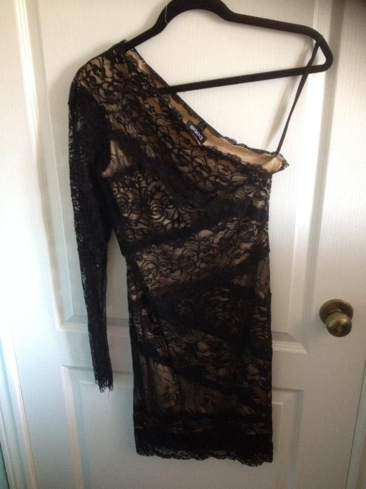 Limited. Bebe Dress. beautiful nude illusion, the lace work has some beading on the sleeve and the hem of the dress.Size medium with some stretch. This is a stunner but haven't had a chance to wear it. 40$ + shipping
