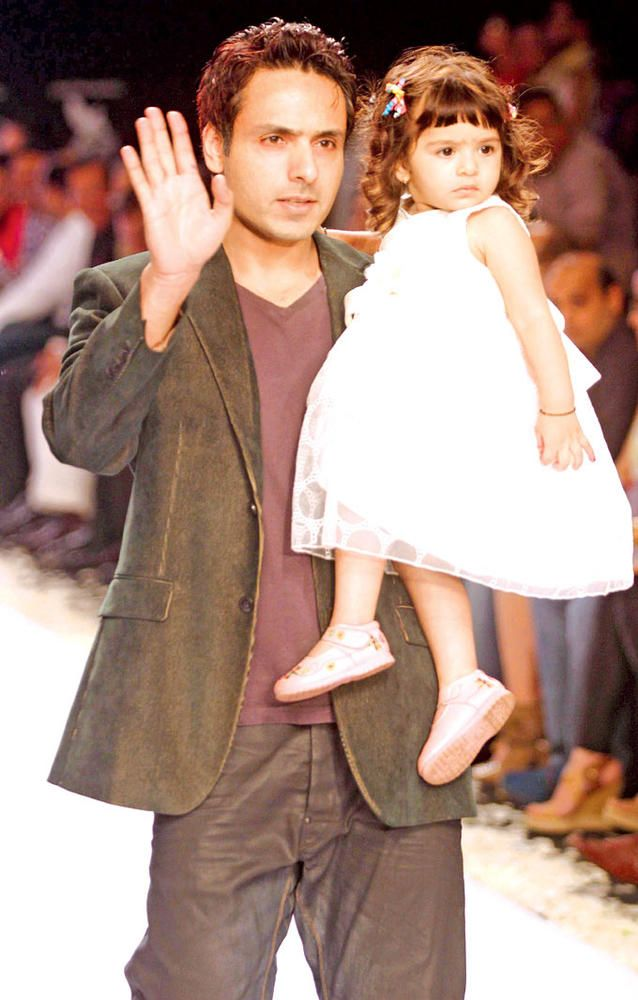 TV actor Iqbal Khan with daughter at the India International Jewellery Week 2013. #Bollywood #Fashion