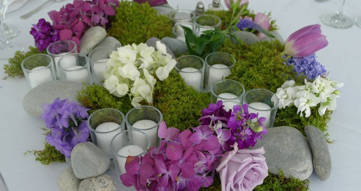 Love this moss, flower, and candle centerpiece!  Would look amazing with peonies.