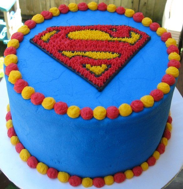 Superman. We will def do something more elaborate than this! Cupcakes or 2 tiers!