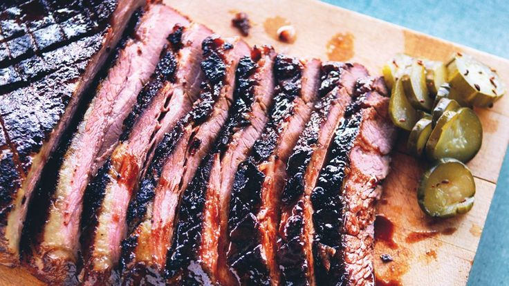 This brisket recipe calls for a bath of stout, bourbon, and soy sauce; a glaze made with peach jam; and a side of easy homemade pickles.