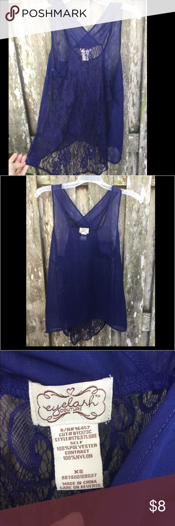 Sheer Navy blue tank top Sorry it doesn't photograph well! It has a lacy back, with a cris-cross straps that expose your shoulders. Sheer. Tops Blouses