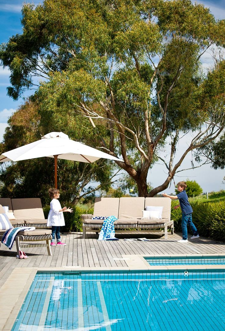"""This pool area is part of the Highfields garden at Romsey, in country Victoria. """"It's a quintessential Australian scene, so I didn't want to go closing the pool area in with structures and shelters or creating a French-inspired garden around it,"""" says landscape designer [Rick Eckersley](http://e-ga.com.au/