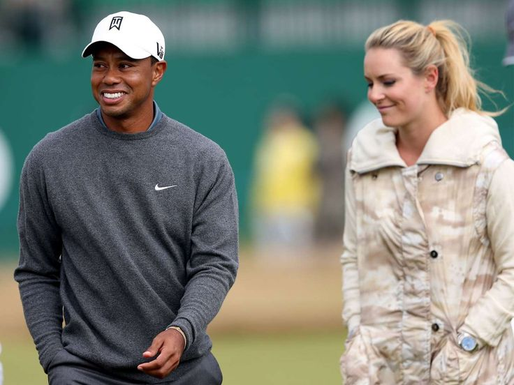 Good times here again  -    Tiger Woods and his girlfriend US skier Lindsey Vonn, are seen together during a practice round ahead of the British Open Golf  Championship, Muirfield, Scotland, Monday, July 15, 2013.