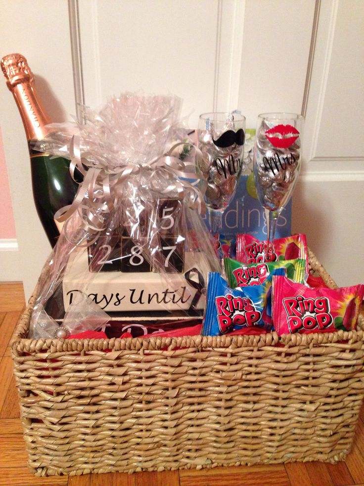 engagement gift basket: champagne glasses, countdown to wedding day blocks, wedding books/magazines, champagne, hershey kisses, and ring pops | easily customizable for different couples ~ made by me | instagram: nicandri
