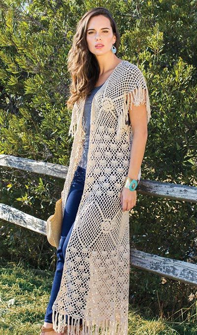 Long Fringe Crocheted Vest The perfect topper for a chic daytime look or a casual evening out! Layer open-front, crocheted, ecru cotton vest over a classic tee, crisp button-down or swingy frock for a lively yet polished outfit. Fun fringe at the bottom and sleeves adds extra flair. Machine wash.
