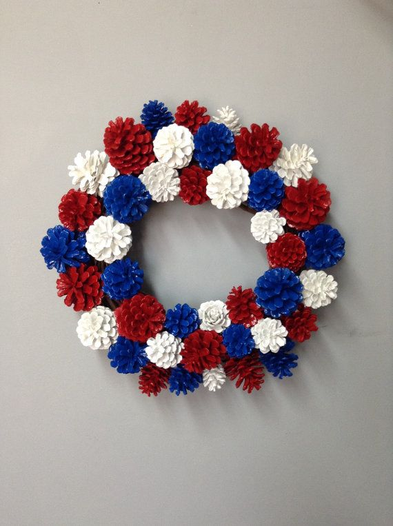 This patriotic pinecone wreath is 12 inches in diameter. With the pinecones the wreath is now 15 1/2 inches. The pinecones are painted red, white, and blue. This wreath is a little heavy so it will need a secure hook or nail. It would also look great on a table with a candle in the middle, or a vase with patriotic flowers. We can make wreaths for any occasion! Custom orders accepted! www.etsy.com/shop/SheilasGardenGirls