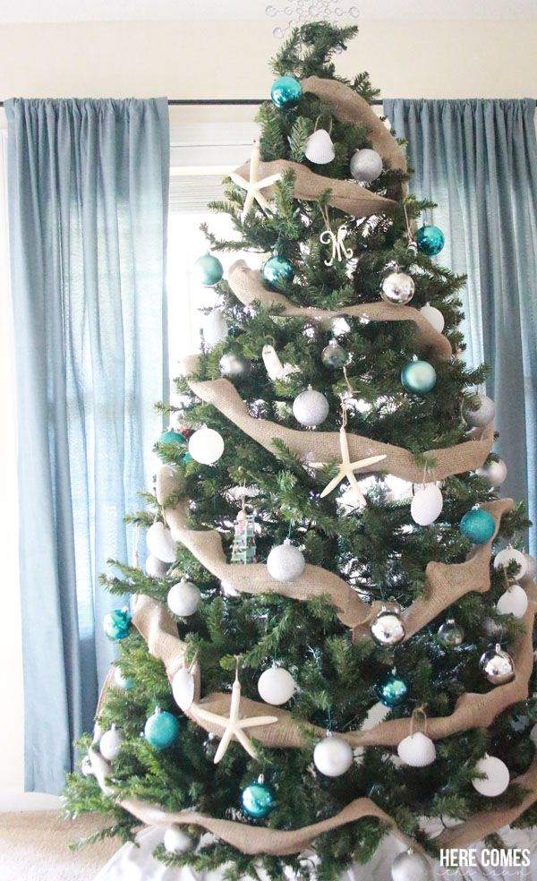 I LOVE this Coastal Christmas tree! Such cute ornaments and what a great idea to use a burlap garland!