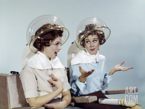 1960s 2 Women Sit under Beauty Salon Hair Dryers Clear Helmets Hoods Curlers Talking Gossip Photographic Print at Art.com