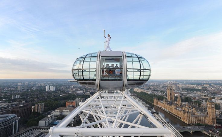 Amelia Hempleman-Adams with the Olympic Flame on top of a London Eye pod on the Torch Relay leg through London (AP/LOCOG)