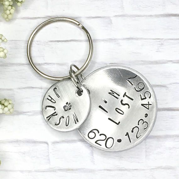 """This ID tag just may be your loyal companion's ticket home should he or she manage to get out. You will receive 2 tags total in this set. The larger 1.25-inch tag has your phone number clearly stamped around the perimeter of the disc. The words """"I'm lost"""" are stamped above your phone"""