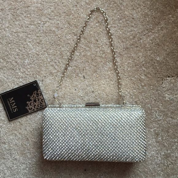 NWT Diamond studded clutch/cross body Never been used clasp clutch has two chains, can convert to a cross body, shoulder, or clutch perfect for any occasion. MMS Design Studio Bags Clutches & Wristlets
