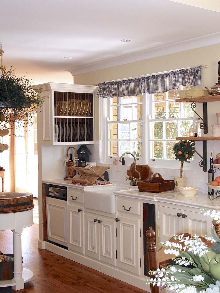 This French farmhouse kitchen with tiled benchtop, plate rack and butler sink - French provincial style in Sydney, Australia