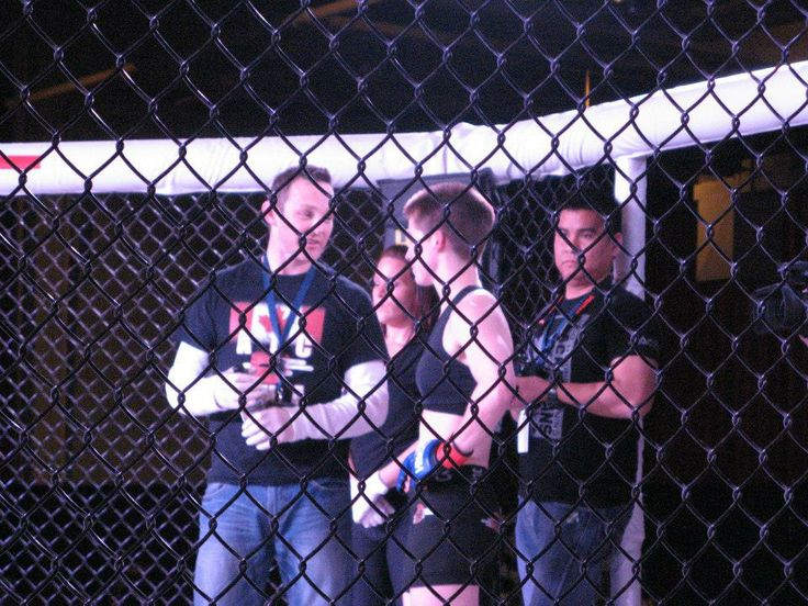 In the ring with coach and fighter.