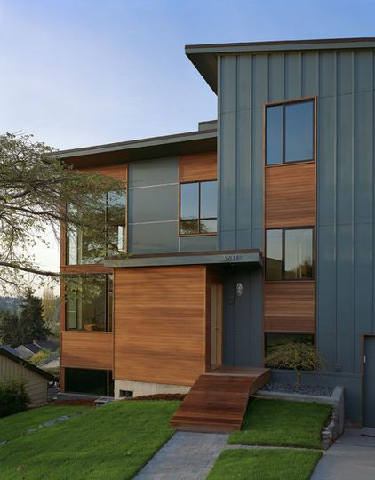 For modern architecture with wood siding, try a deep gray. Gray tones look great with wood siding with red undertones. Here is Knoxville Gray HC-160 by Benjamin Moore.