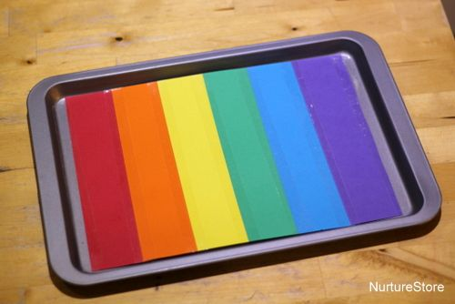 This is clever. Line a cookie sheet with rainbow colors and pour a layer of salt or rice over the top. Kids write letters or words using their fingers (for sensory) or craft sticks.