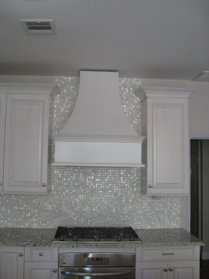 I love this backsplash tile - iridescent and so pretty. This is really pretty tile. What's neat about the color and effect is that you can pair it with light colors like peach or sea green for a softer look, or add bold color accents like sapphire or emerald.