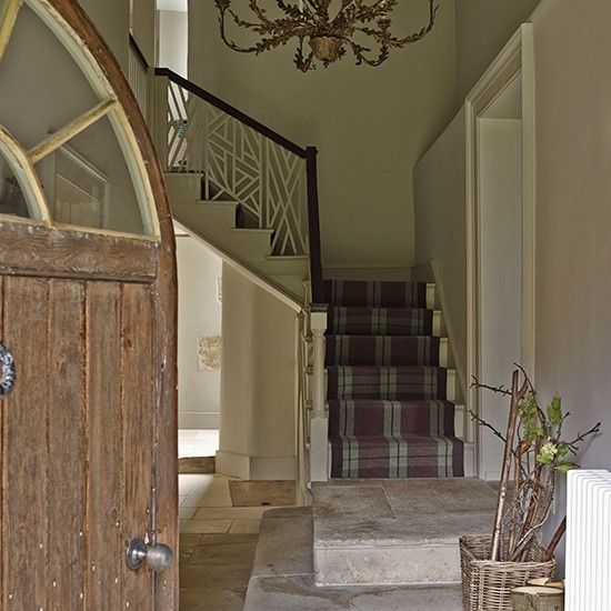 Rustic entrance hall with tartan stair runner | Renovated Wiltshire manor house | House tour | PHOTO GALLERY | Homes & Gardens | Housetohome.co.uk