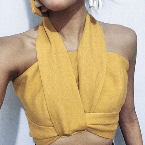Love yellow and the way it looks like the fabric is just wrapped around her.
