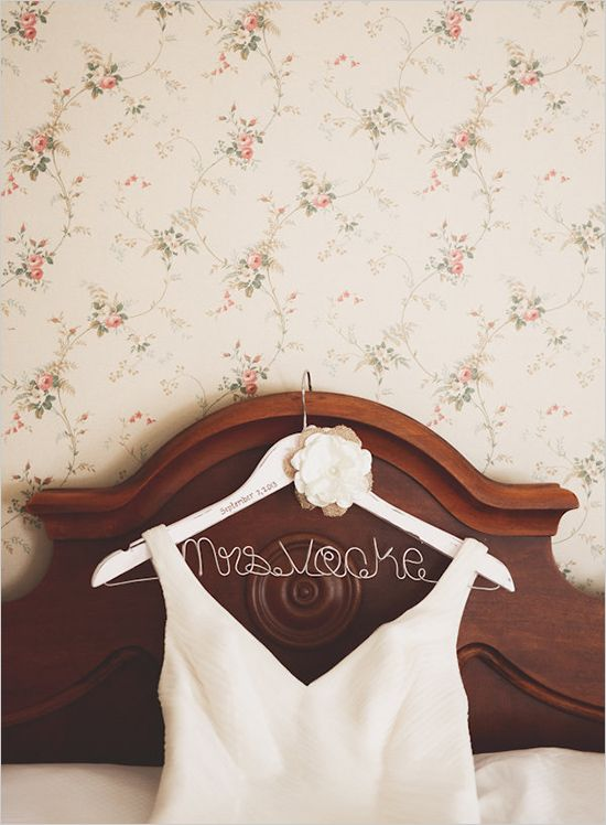 Cute white wire hanger for the bride's dress. Captured By: Sarah Murray Photography --->  http://www.weddingchicks.com/2014/05/13/quirky-budget-friendly-wedding/