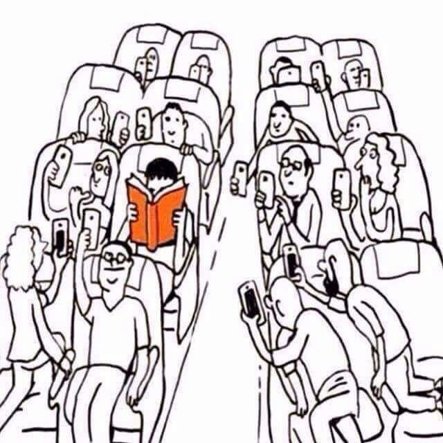 me with my head in a book while everyone else is messing around with their phones! yup. lol