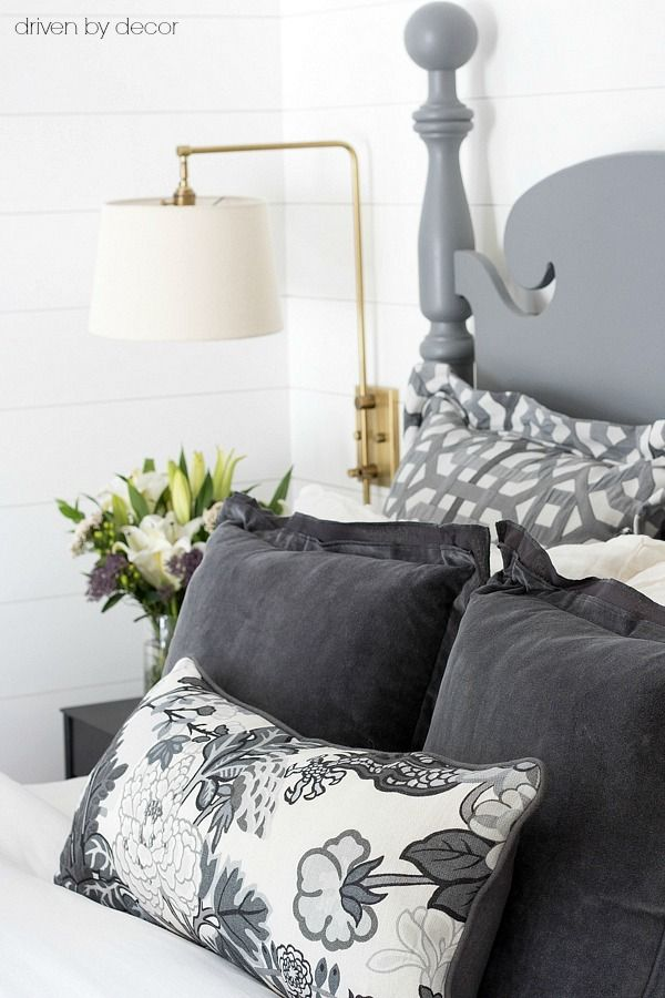 Gray velvet pillows cozy up this master bed for fall