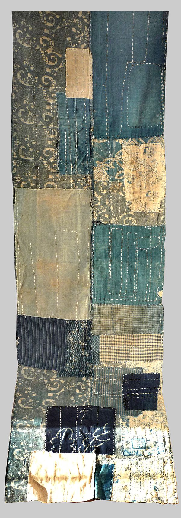 Japanese Indigo Boro. (front)  Composed in 1900 but made of earlier fragments of shibori,katazome and kasuri.  from Esther Fitzgerald Rare Textiles