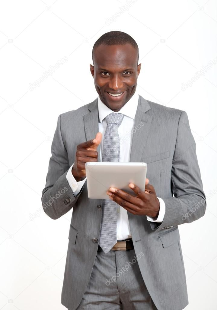 Businessman On White Background Using Electronic Tablet Royalty