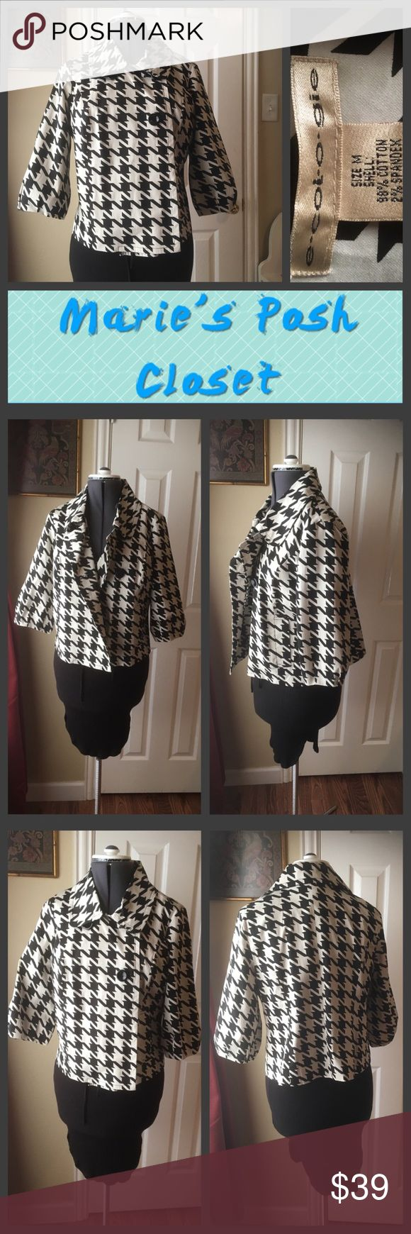 Houndstooth Jacket Lovely, large, black and white houndstooth checks on this short, jacket with 3/4 puffy sleeves and a broad brimmed collar. Kind of a trapeze style. e-col-o-gie Jackets & Coats Blazers