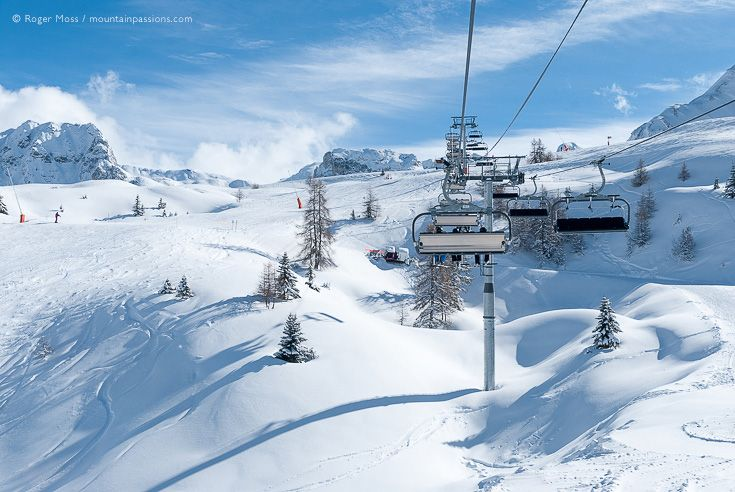 View of ski area from chair-lift after fresh snow in La Plagne, Paradiski, French Alps.